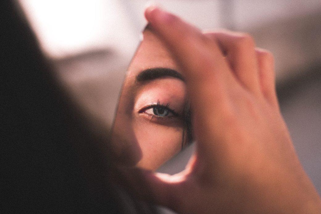 reflection-of-woman-s-eye-on-broken-mirror-2282000